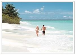 On the beach at Four seasons resort Maldives