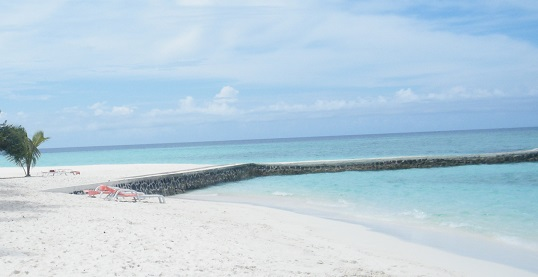 Maldives islands with a sea wall - groynes