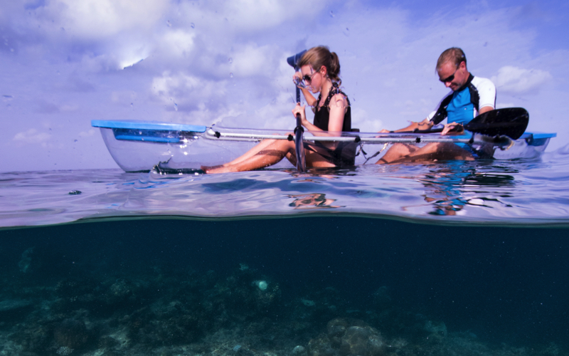 Kayaking in glass bottom boat, Maldives