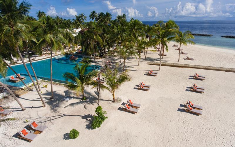 Dhigali Maldives Resort pool and beach