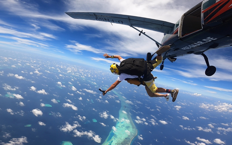 sky diving in the Maldives.
