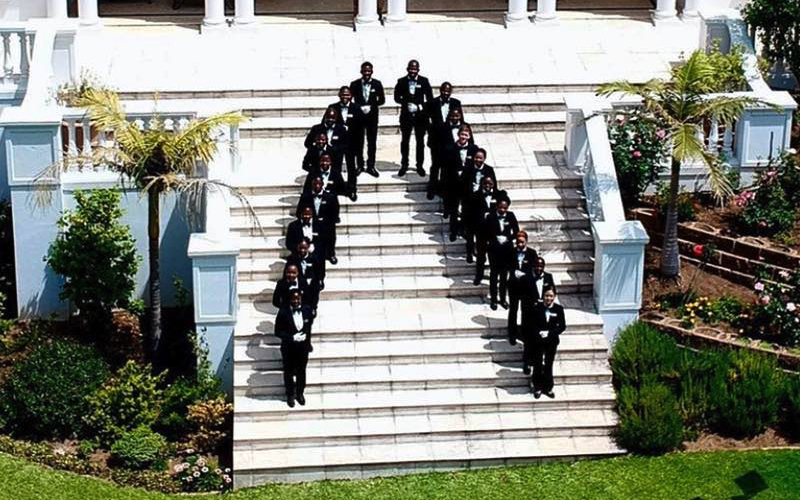 Butlers on the steps at SABA