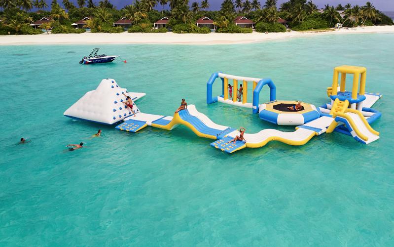 Inflatable water park at The Standard Huruvalhi Maldives.